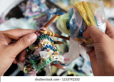 Cut nylon bag into yarn and woman hand knit to basket, good idea to recycling nylon bag to reduce environmental pollution