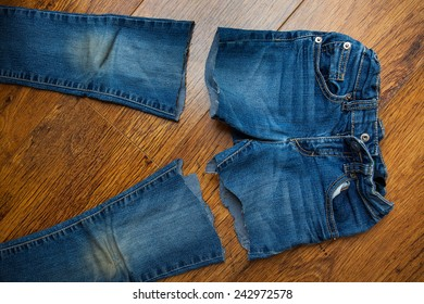 cut old jeans on wooden boards