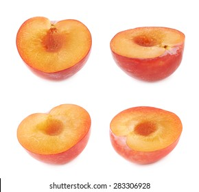 Cut open half of a red victoria plum isolated over the white background, set of four different foreshortenings