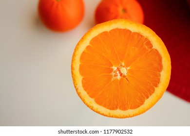Cut orange and clementine on the kitchen table