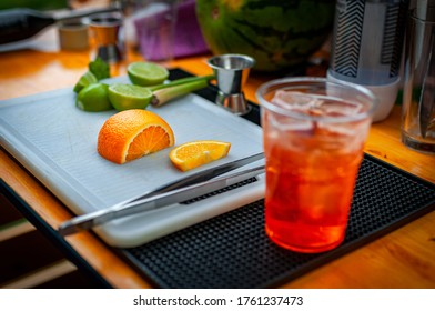cut orange during preparation of cocktail.