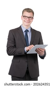 Cut out image of a young smiling businessman who is using a tablet. The man is looking to the camera.