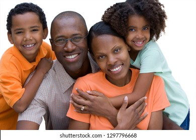 Cut out of smiling family hugging at camera on white background