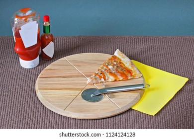 Cut out triangle of pizza on circle wooden chopping board