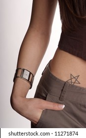 cut out a woman with tattoo and hand in trouser pocket