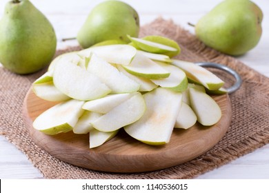 Cut pears on wooden board on a table
