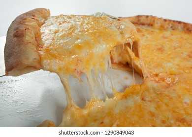 the cut piece of pizza and the lasting melted cheese