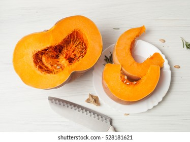 cut a piece of pumpkin seeds on a light background, healthy food