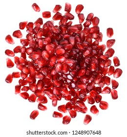 Cut the pomegranate with scattered grain top view isolated on white background.