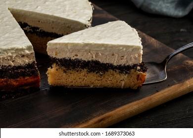 Cut poppy cake with orange layer