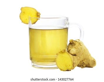 Cut rhizome of fresh root ginger, or Zingiber officinale, with a glass of fresh infusion or tea used to aid weight loss and as a treatment for dyspepsia, on a white background