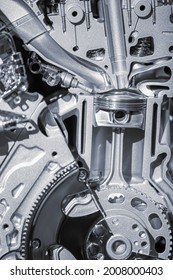Cut section of automotive engine showing piston and connecting rod