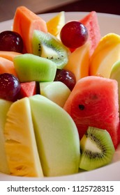 cut several tropical fruit in plate