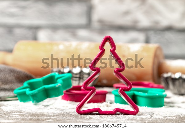 Cut shape of red Christmas tree cookies. Christmas cookies shapes on the table