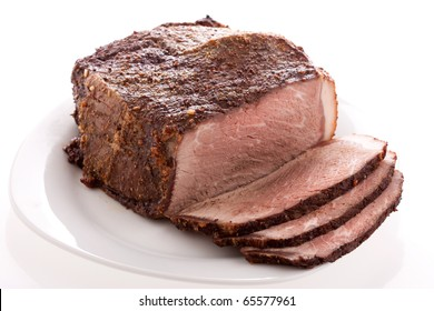 Cut sirloin beef on a plate, baked in oven