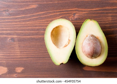 cut slices of avocado on a table