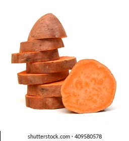a cut sweet potato on a white background