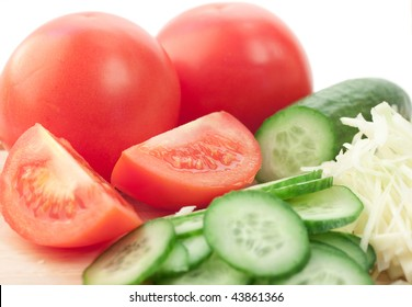 cut vegetables by a large plan; white background