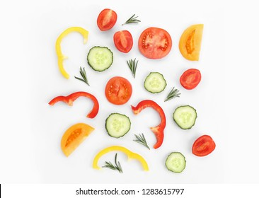 Cut vegetables on white background, flat lay