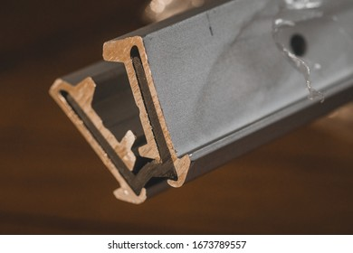 Cut view of an aluminium waterproof hinge, used to make wwater tight door flaps. Aluminium profile with rubber insert to allow flexing, used as a hinge.