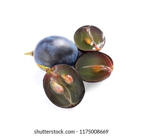 Cut and whole fresh ripe juicy grapes with seeds on white background