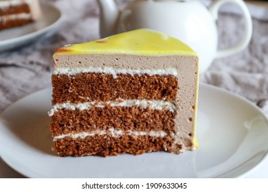 cutaway chocolate cake with mousse and yellow icing glaze