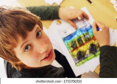 Cute 12 years old autistic boy drawing