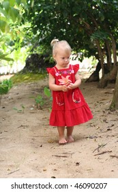 Cute 2 years old girl outdoors at sunny summer day