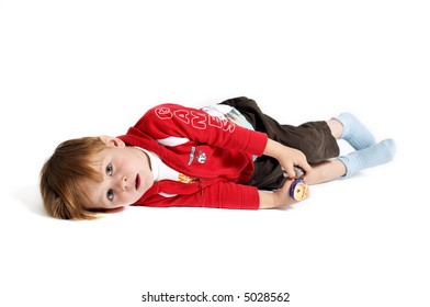 Cute 3-years old casual dressed boy playing with toys. Isolated on white background.