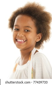 A cute 7 year old African girl in the studio against a white backdrop.