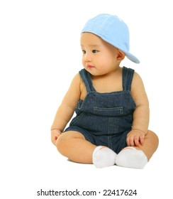 cute 8 months old baby wearing jeans look to the side