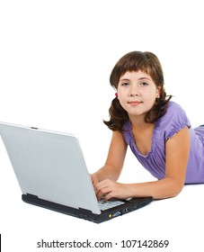 A cute 9-year-old girl with brown hair, wearing purple top, working with a laptop, looking ito the camera - isolated on white