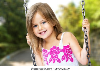 Cute active kid swinging on a swing