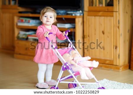 cute adorable baby girl making first stock photo edit now