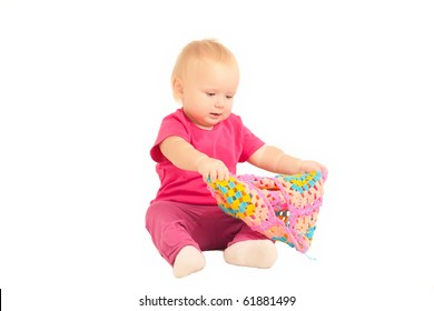 cute adorable baby play with huge knitted cap on white