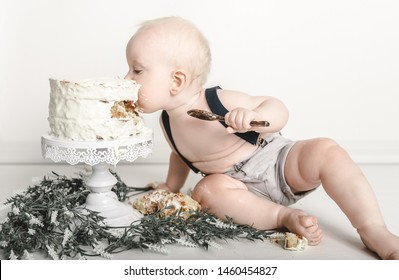 Cute adorable happy baby enjoying cake