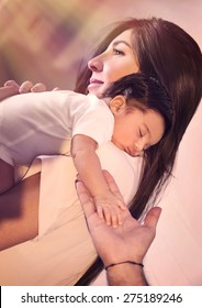 Cute adorable newborn daughter sleeping on mothers shoulder and father with tenderness holding her tiny hand, love concept