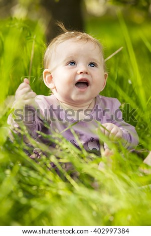 Image of: Lovely Cute Adorable Nice Baby Girl In Green Grass Sitting Under Sakura Tree Shutterstock Cute Adorable Nice Baby Girl Green Stock Photo edit Now 402997384