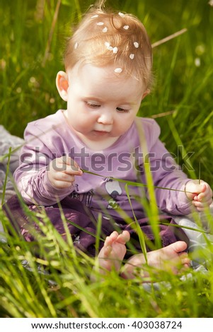 Girl Cute Adorable Nice Baby Girl In Green Grass Sitting Under Sakura Tree Shutterstock Cute Adorable Nice Baby Girl Green Stock Photo edit Now 403038724