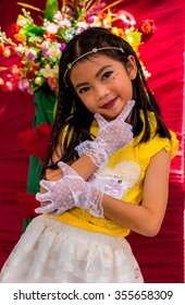 Cute adorable Thai kid and flowers.