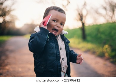 Cute African American Boy playing with Mobile Phone