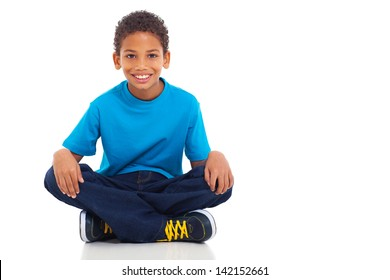 cute african american boy sitting on white background