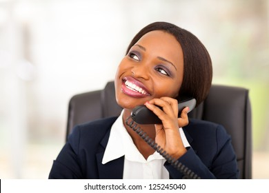 cute african american businesswoman talking on phone