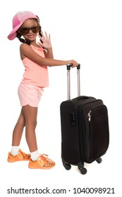 Cute african american girl carrying a travel suitcase and waving goodbye - Isolated on white