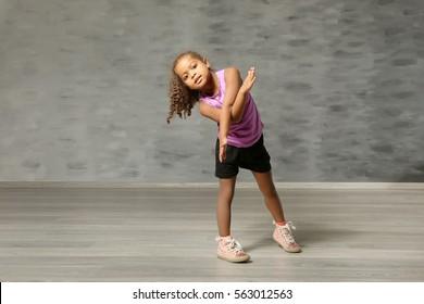 Cute African American girl in dance studio