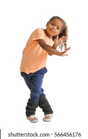 Cute African American girl dancing on white background