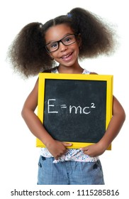 Cute african american girl with glasses holding a sign with a famous physics formula - Isolated on white