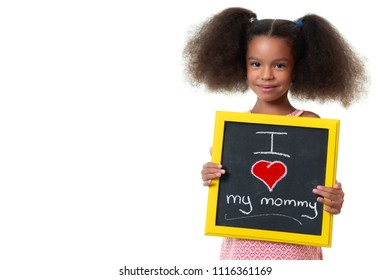 Cute african american girl holding a sign with the phrase I love my mommy - Isolated on white