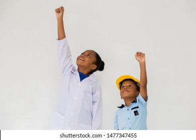 Cute African American kids in white lab coat and yellow helmet flying up isolated on white background