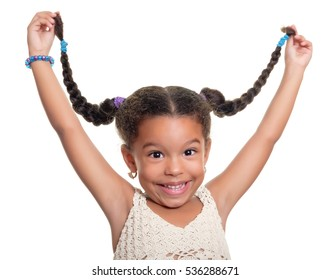 Cute african american small girl laughing and pulling her hair isolated on a white background